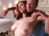 Mimi Rogers exposes huge tits and gets oil massage