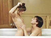 Marie Trintignant shows hairy pussy in a bathroom