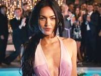 Megan Fox exposing boobs through totally wet dress