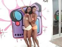 Sexy ebony girls Brandi Foxx and Lotus Lain tease you through the camera.